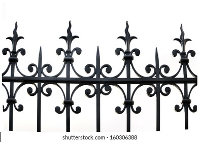 part of a wrought iron fence on white background