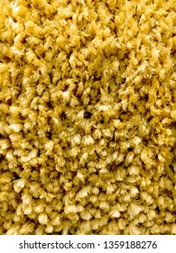 Part of a yellow long pile carpet as a background