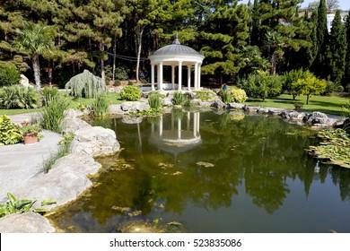 "PARTENIT, CRIMEA - SEPTEMBER 7, 2016: Photo of Park ""Ayvazovskoe"" (""Paradise""), antique garden, view of the rotunda."