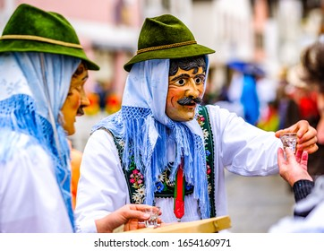 Partenkirchen, Germany - February 23: participants of a carnival parade with traditional  costumes called 'maschkera' on February 23, 2020 in Partenkirchen