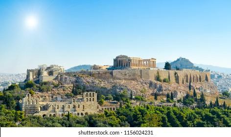 Parthenon acropolis sky sun spring in   Athens Greece