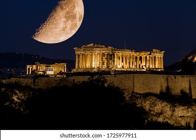 Parthenon of Athens under a huge magnificent moon, at dusk time,  Greece