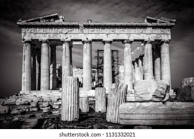 Parthenon on the Acropolis of Athens in black and white, Greece. It is a main landmark of Athens. Temple ruins on the top of hill in Athens center in twilight. Ancient Greek text about Parthenon.