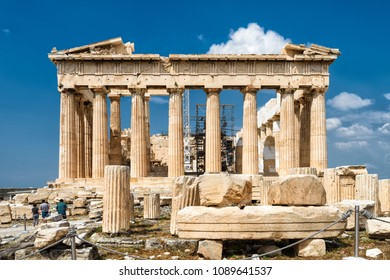 Parthenon on the Acropolis of Athens, Greece. The famous ancient Greek Parthenon is the main landmark of Athens. Ruins of Parthenon or temple of Athena at the top of mountain.