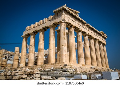 Parthenon on the Acropolis of Athens, Greece. The famous ancient Greek Parthenon is the main landmark of Athens. Ruins of Parthenon or temple of Athena at the top of mountain