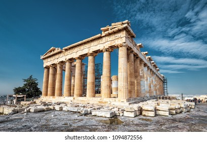 Parthenon on the Acropolis of Athens in summer, Greece. Ancient Greek Parthenon is the main landmark of Athens. Beautiful view of the famous temple ruins on the top of hill in Athens center.
