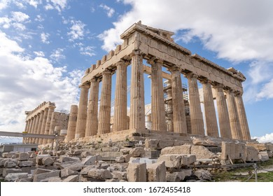 Parthenon remains in Acropolis Hill on a sunny day , Athens-Greece