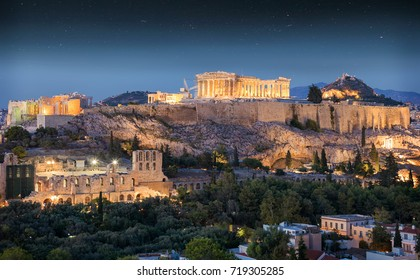 The Parthenon Temple at the Acropolis of Athens, Greece, in the night with stars in the sky