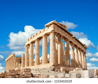 Parthenon temple on a bright day with clouds. Acropolis in Athens, Greece
