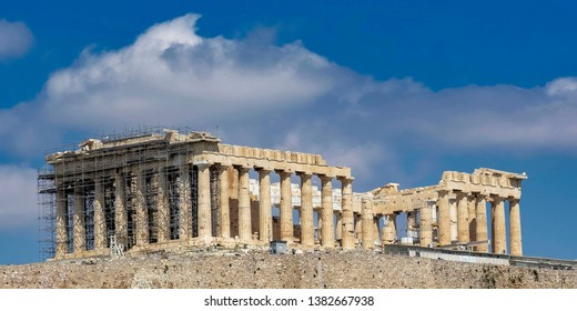Parthenon temple, one of the 7 ancient world wonders on Acropolis of Athens under blue sky with some clouds, Greece
