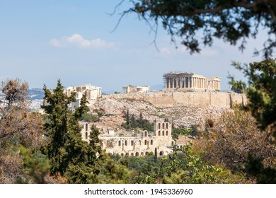 Parthenon view from Filopappou Hill. There can be seen the facade and the southern side of the Parthenon temple, of 5th century BC, on the sacred Akropolis Hill, in Athens, Greece, Europe