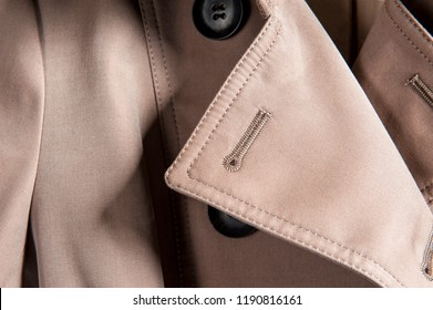 Partial close-up of the neckline of a lady's trench coat