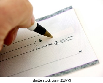 partial hand endorsing a check,shallow dof