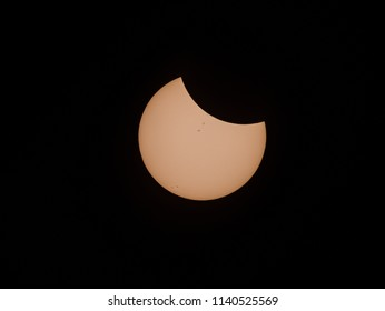 Partial phase of the August 21, 2017 total solar eclipse, with sunspots visible