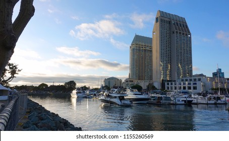 Partial San Diego skyline with the towers of the Manchester Grand Hyatt hotel and boats in the Marina