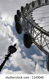 Partial Silhouette Of The London Eye With An Ornate Lamp Post