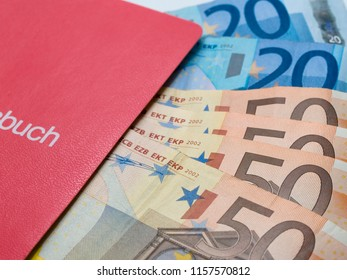 Partial view of a bankbook with banknotes buch means book