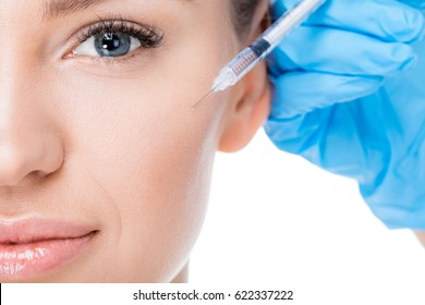partial view of female botox injection on white