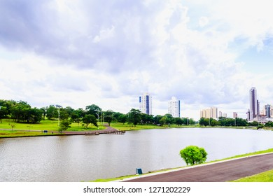 Partial view of the lake in the Parque das Nações Indígenas and buildings in the background, in the city of Campo Grande, capital of Mato Grosso do Sul, Brazil. City in the middle of nature.