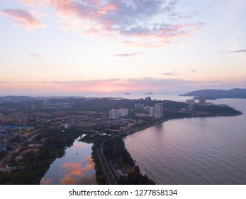 Partial view of lake wetland and partial view of Kota Kinabalu city during beautiful sunset.