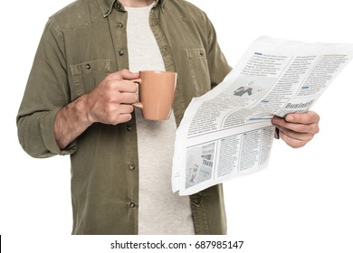 partial view of man with cup of coffee and newspaper isolated on white