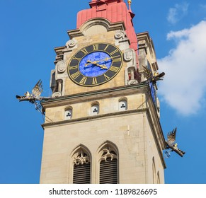 Partial view of one of two towers of the City Church of Winterthur (German: Stadtkirche Winterthur) in Switzerland against blue sky.