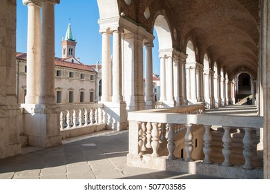 Partial view of the Palladian basilica in Vicenza with a view of the facing St Vincenzo church in the background