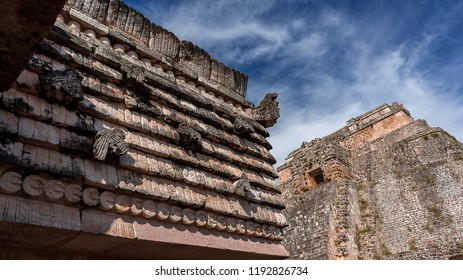 Partial view of the Pyramid of the Magician, and frieze detail from the Quadrangle of the Birds, in the ancient Mayan city of Uxmal, located in the Puuc region in Yucatan, Mexico