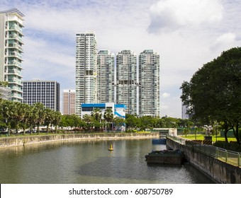 Partial view of river and buildings in Singapore on a cloudy day