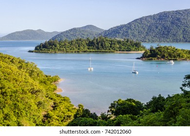 Partial view, Shute Harbour, islands and Conway National Park, from the mainland at Shute Haven, The Whitsundays, Australia. Tropical climate. The Tropics. Copy space.