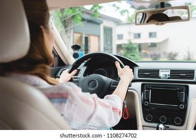 partial view of woman driving car alone