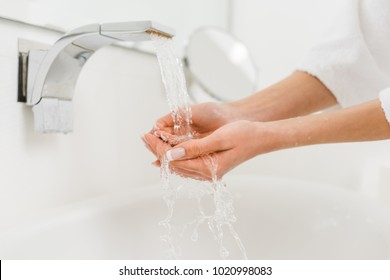 partial view of woman washing hands at home