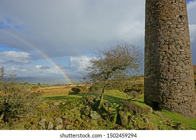 A partial winter rainbow over Bodmin Moor and the abandoned ruins of the Wheal Jenkins engine house, Cornwall, UK