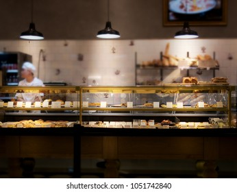 Partially blurred of bakery shop with bakery showcase and varieties of bakery products