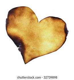 Partially burned paper heart close-up
