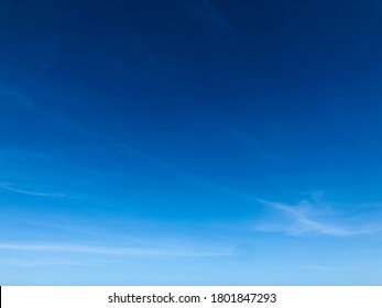 Partially cloudy. Hazy sky view. Pure white fluffy cloudy against bright blue sky. Moment of natural climate scenery.