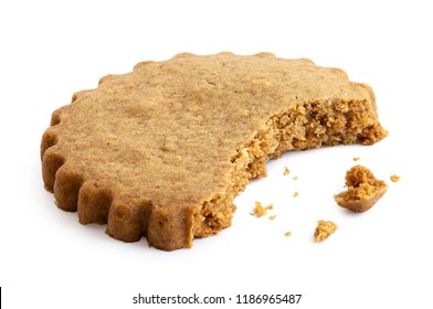 Partially eaten round gingerbread biscuit isolated on white. Serrated edge.
