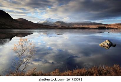 A partially frozen Lochan na h-Achlaise and the Black Mount mountain range, Rannoch Moor near Glencoe,Scotland.
