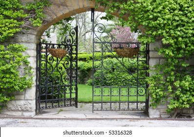 A partially open gate, entrance to a garden