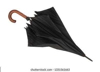 Partially open umbrella on white