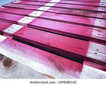 Partially Sprayed Red Wooden Pallet Texture Background