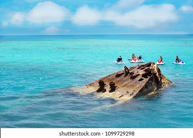 Partially submerged shipwreck on Bermuda Islands, tourist attraction diving site