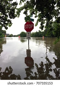 A partially submerged stop sign after Hurricane Harvey