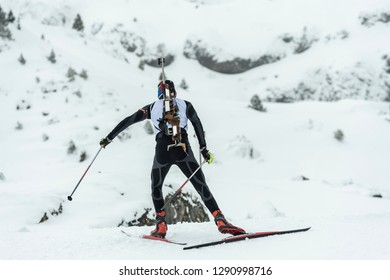 A participant in a biathlon competition during a winter sports event in Spain.
