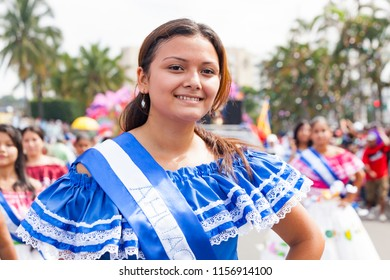 A participant in the parade shows her dress at the Independence Day parade in El Salvador in the city of San Salvador on September 15, 2010.