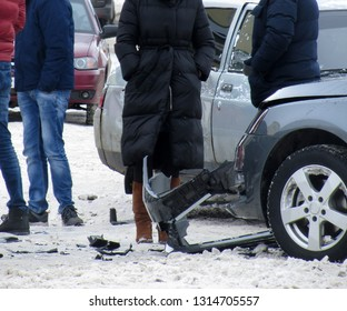 Participants of the car accident and passers-by on the scene of the accident