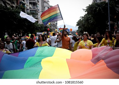 Participants carry the rainbow flag as they march during the Gay Pride parade in Thessaloniki, Greece on June 20, 2015