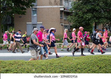 Participants of the Nijmegen Four Days Marches of Vierdaagse Loop. Pink Wednesday (roze woensdag). 19 July 2017. Center of Nijmegen, the Netherlands.