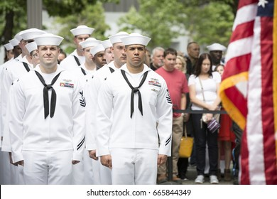 Participating U.S. Navy personnel stand at attention at the re-enlistment and promotion ceremony at the National September 11 Memorial site. Fleet Week, NEW YORK MAY 26 2017