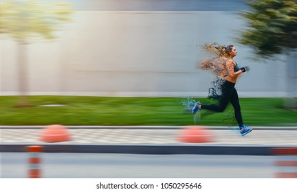 Particle decay effect. Sporty woman runing on street in sportswear. Training sun day. Big gray wall behind